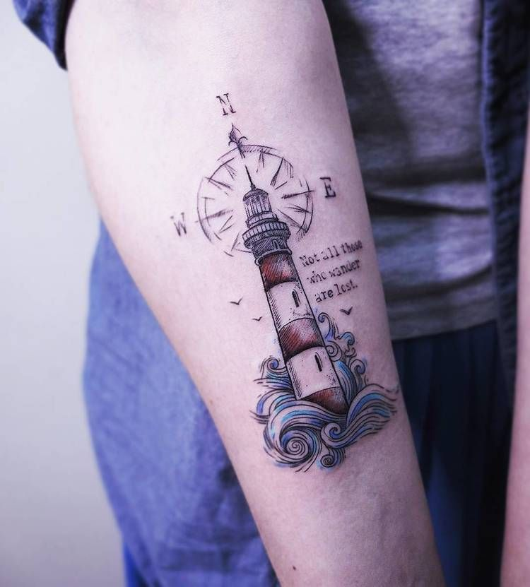 Lighthouse with compass tattoo
