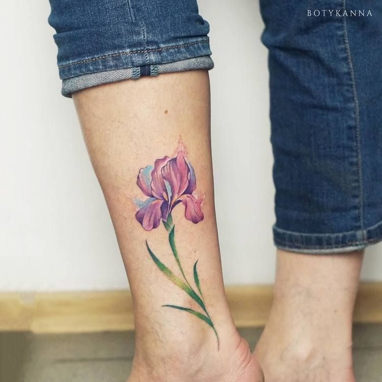 Lily tattoo on the leg