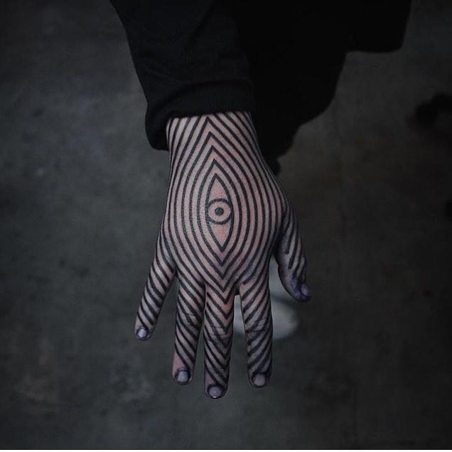 Linear geometric hand tattoo
