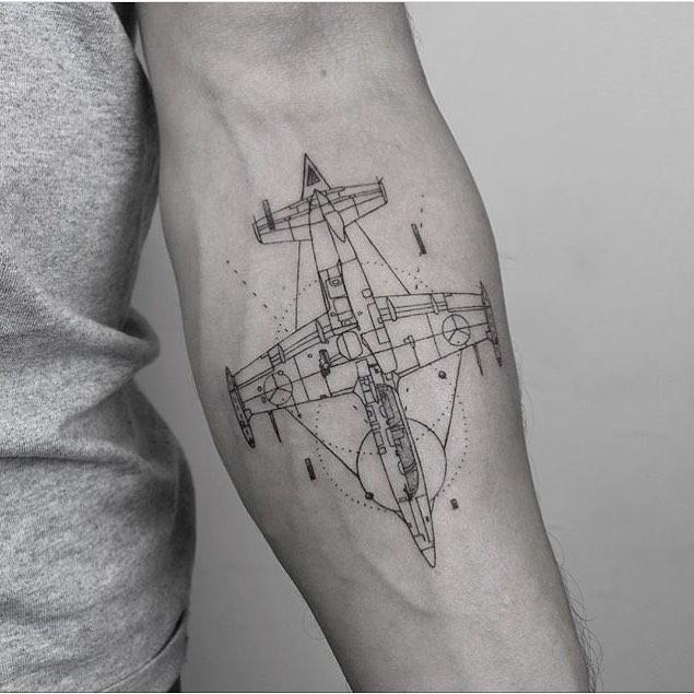 Linear minimal airplane tattoo