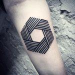 Lines aperture tattoo