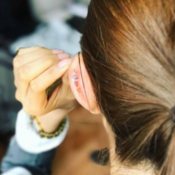 Love tattoo on the left ear