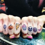 Lovely colorful finger tattoos