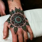Lovely mandala tattoo on the hand