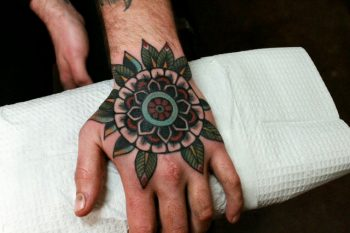 Lovely mandala tattoo on the hand