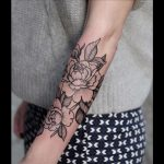 Lovely outline black rose tattoo