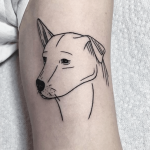 Lovely outline dog tattoo