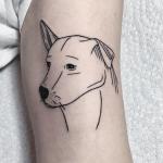 Lovely outline dog tattoo
