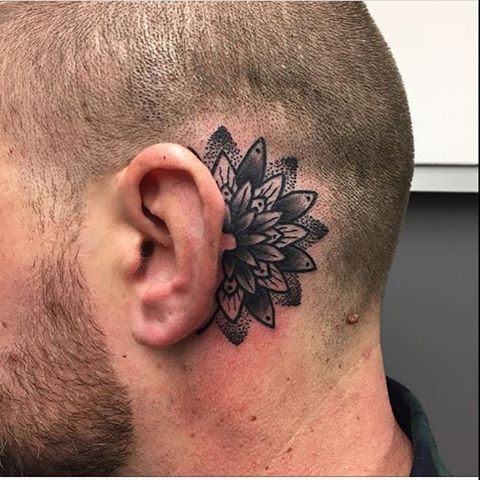Mandala tattoo behind the ear