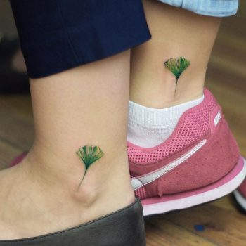 Matching botanical tattoo on the ankle