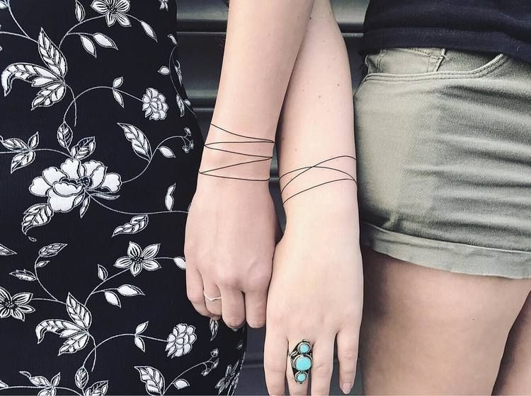 Matching bracelet tattoos