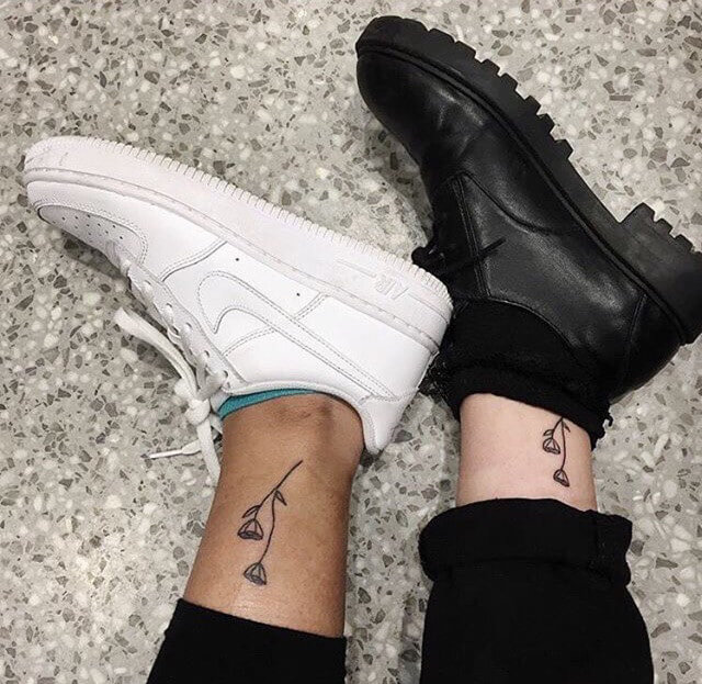 Matching flowers ankle tattoo