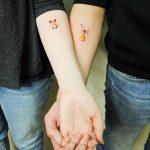 Matching fox tattoos