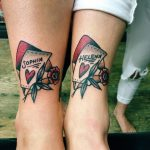 Matching traditional tattoos on ankles