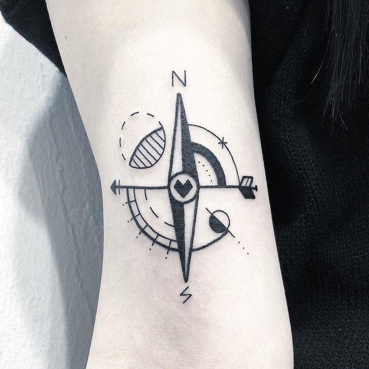 Minimal style compass tattoo