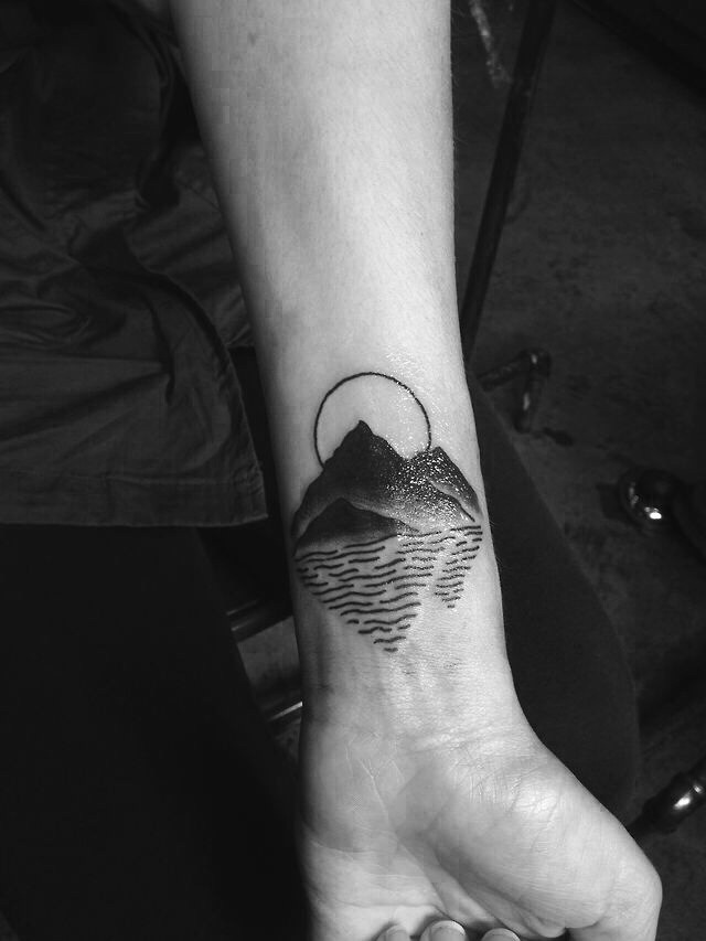 Mountain with a reflection tattoo