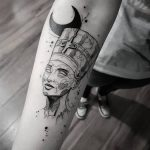 Nefertiti tattoo on the arm