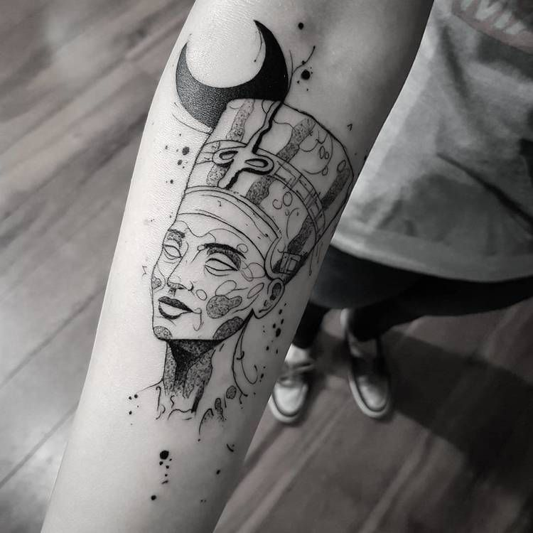 Nefertiti tattoo on the arm
