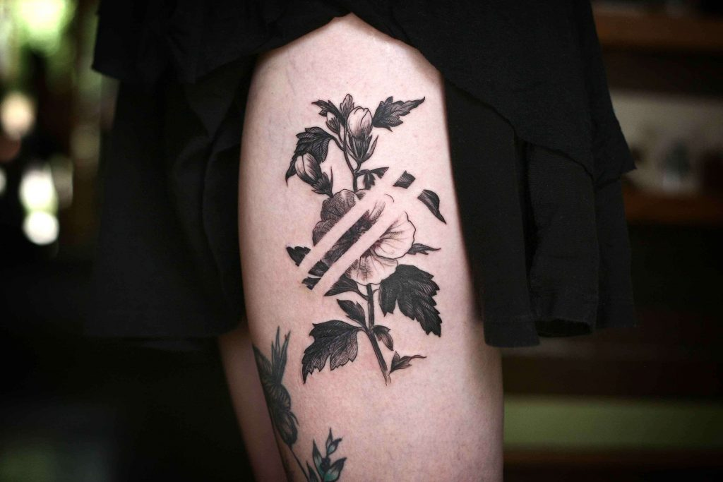 Negative space delicate flower tattoo