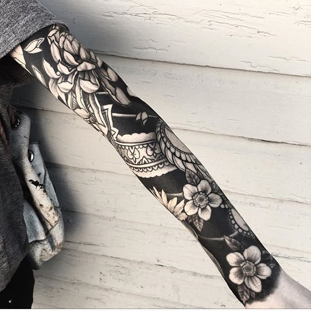 Negative space full sleeve tattoo