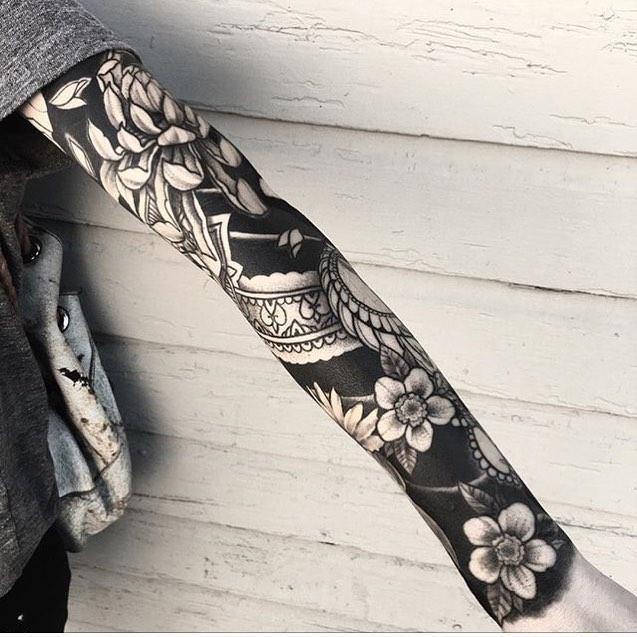 Tattoo Sleeve Negative Space: Black Floral Sleeve Tattoo