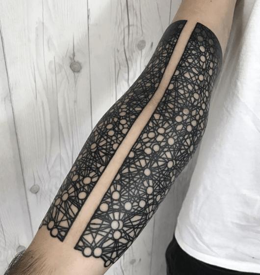 Negative space intense black tattoo