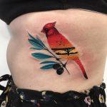Northern cardinal tattoo on a tiny twig
