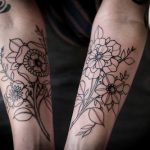 Outline black floral tattoos on both arms