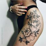 Outline black flower tattoo on the leg