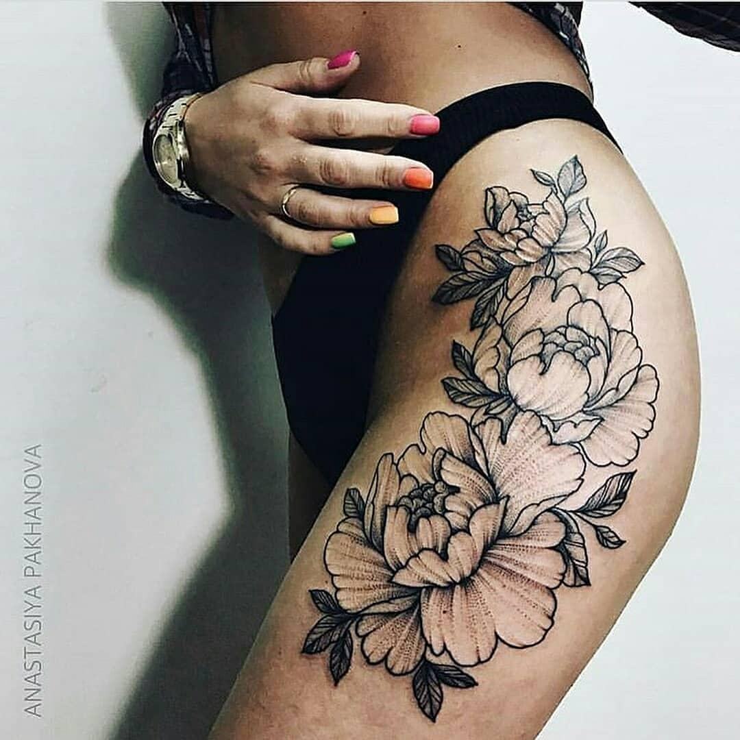 Outline black flower tattoo on the leg