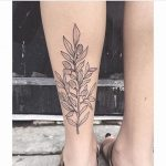Outline floral tattoo on the left calf