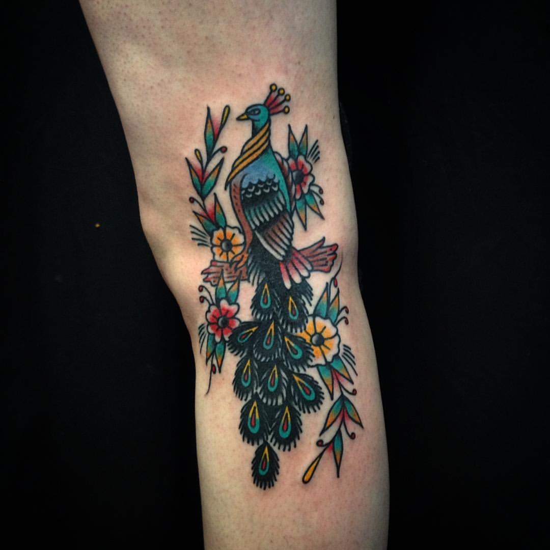 Peafowl tattoo on the arm