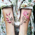 Pink delicate flower tattoos