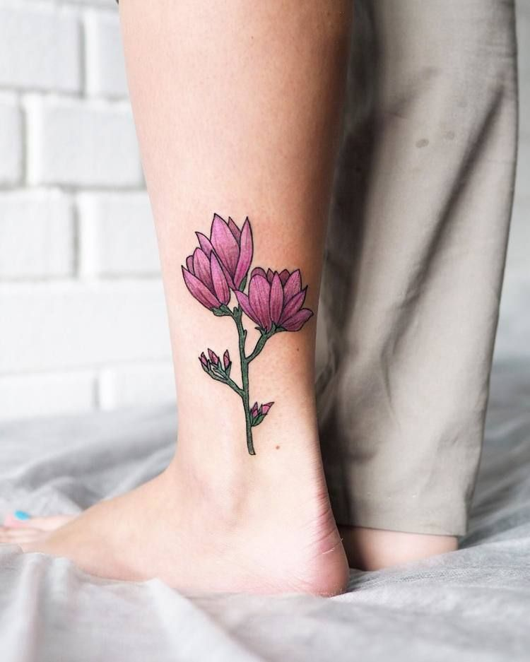 Pink flower tattoo on the ankle