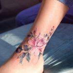 Pink rose tattoo on the ankle