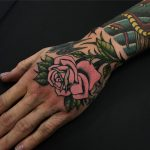 Pink rose tattoo on the hand