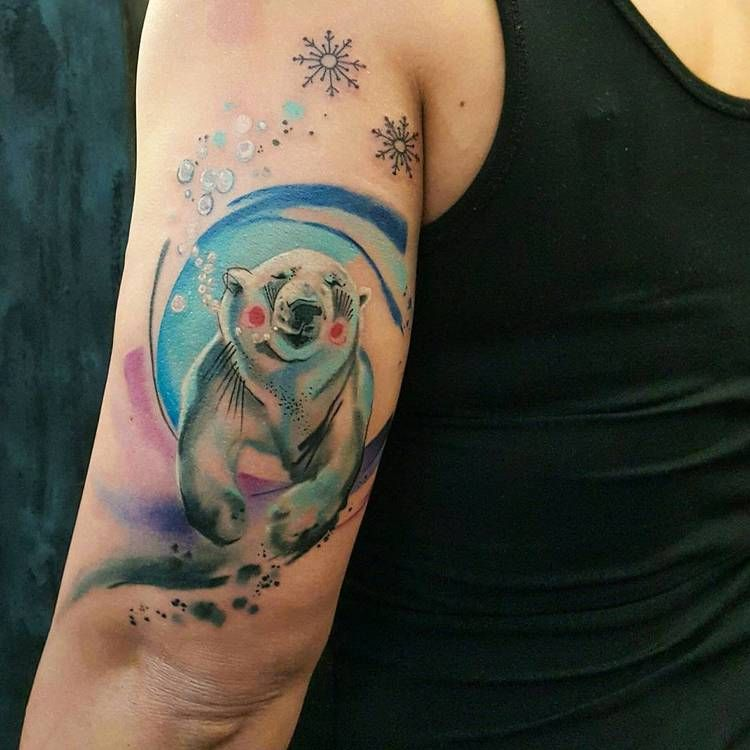 Polar bear tattoo on the arm