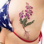 Purple and green wildflower tattoo