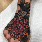 Red and yellow classy mandala tattoo