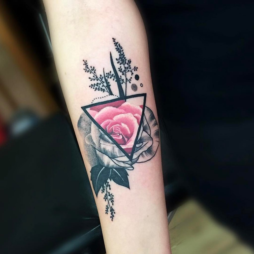 Rose tattoo in a triangle