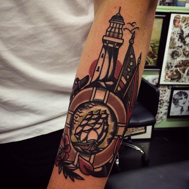 Sailor theme tattoo on the arm