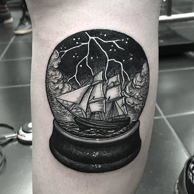 Ship in a crystal ball tattoo