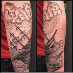 Ship in a sea scenery tattoo