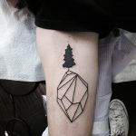 Simple diamond and a black tree tattoo