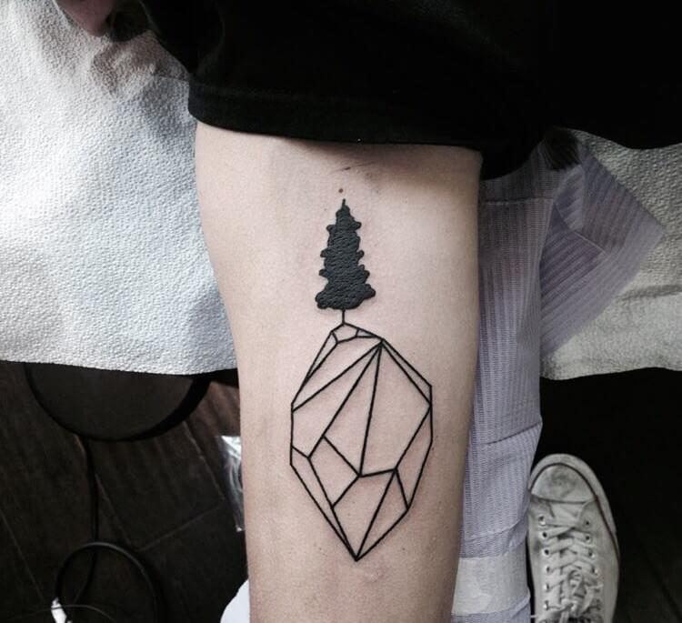 Simple diamond and a black tree tattoo