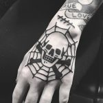 Skull bones and spider web tattoo