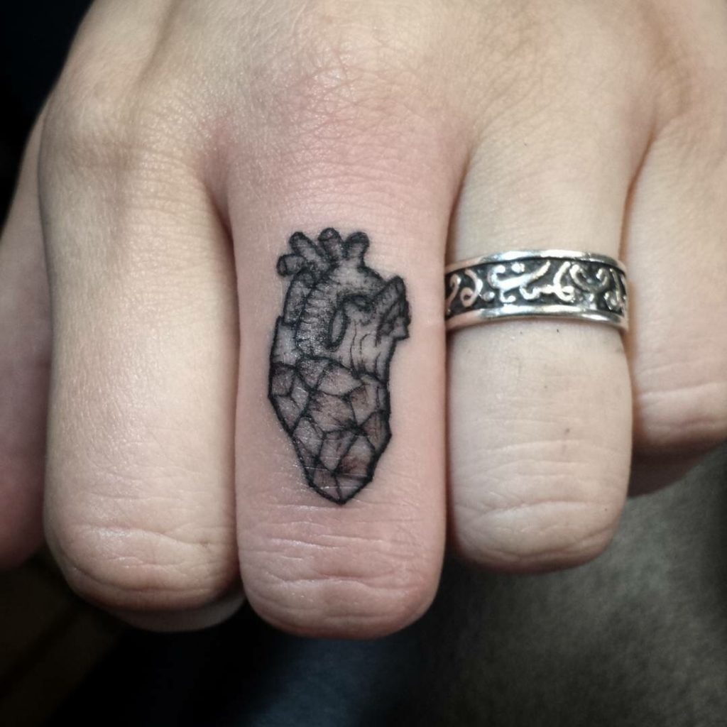 Small antatomical heart tattoo