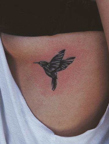 Small black colibri tattoo