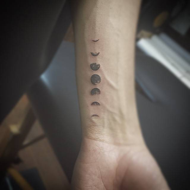 Small moon phases tattoo on the wrist
