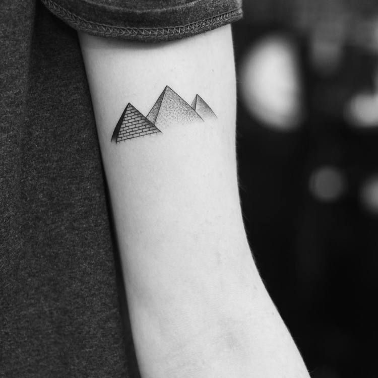 Small pyramids tattoo